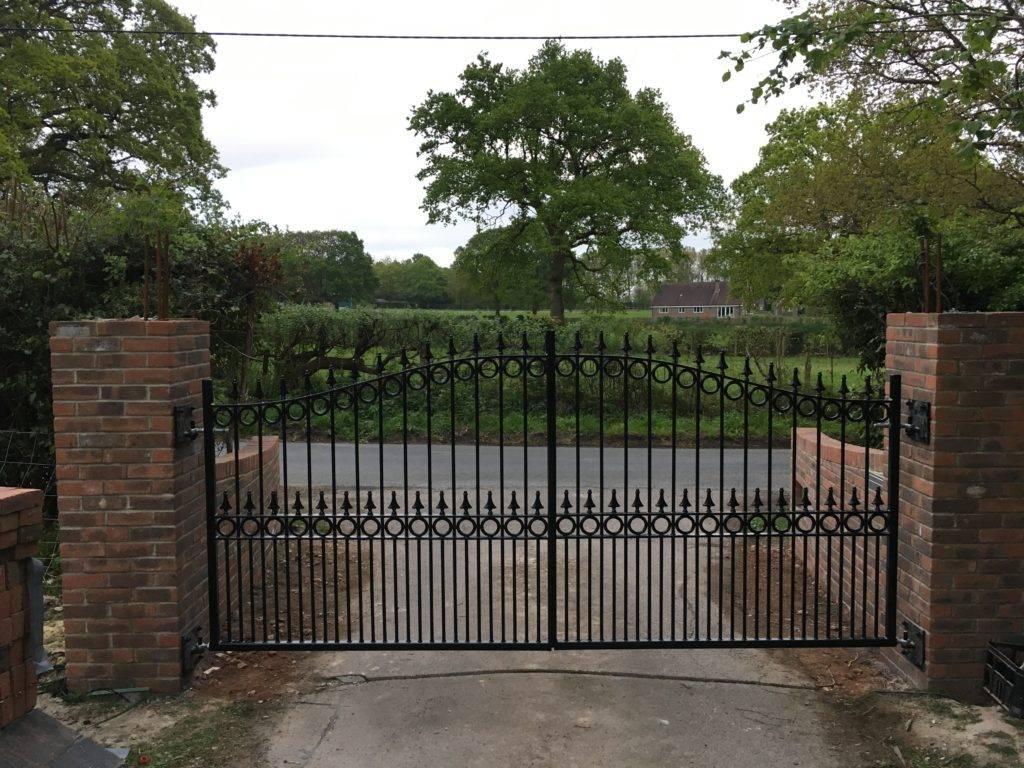 Large black metal driveway gates